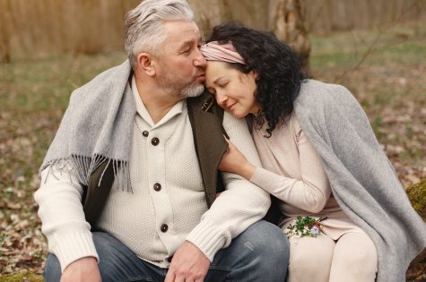 mature couple sitting outside in loving embrace