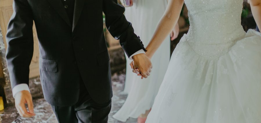 Man in suit and woman in wedding dress