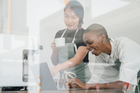 two women working at a computer