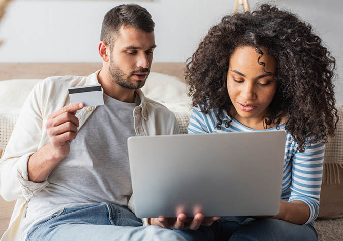 Man and woman entering card information online